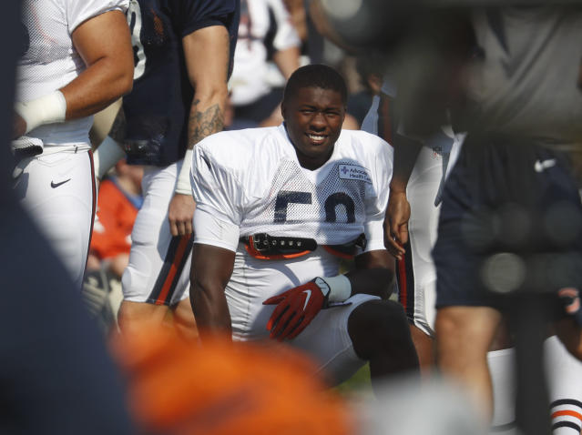 FILE - In this Aug. 15, 2018, file photo, Chicago Bears linebacker Roquan Smith (58) takes part in drills during a joint NFL football training camp session at Broncos' headquarters in Englewood, Colo. They added a potential cornerstone player on defense when they drafted inside linebacker Roquan Smith with the No. 8 overall pick. But they are mostly banking on continuity on that side. (AP Photo/David Zalubowski, File)