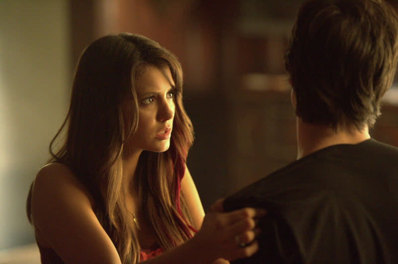 """Graduation"" -- Nina Dobrev as Elena and Ian Somerhalder as Damon"
