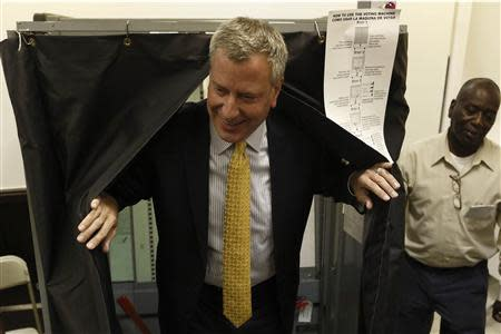 New York City Democratic mayoral candidate Bill de Blasio exits a voting booth after voting in the Democratic primary election in the Brooklyn borough of New York