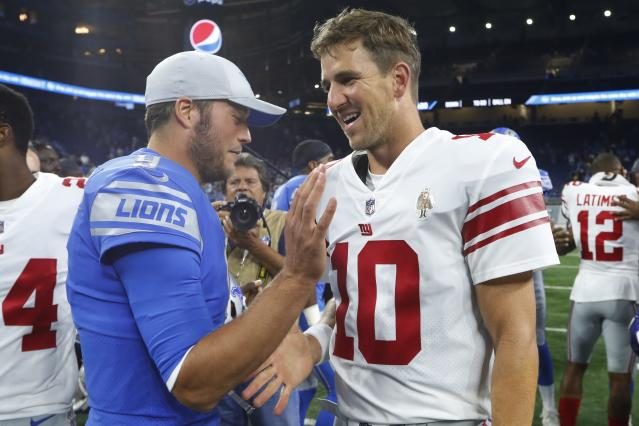Detroit Lions quarterback Matthew Stafford, left, meets with New York Giants quarterback Eli Manning (10) after their preseason NFL football game, Friday, Aug. 17, 2018, in Detroit. (AP Photo/Paul Sancya)