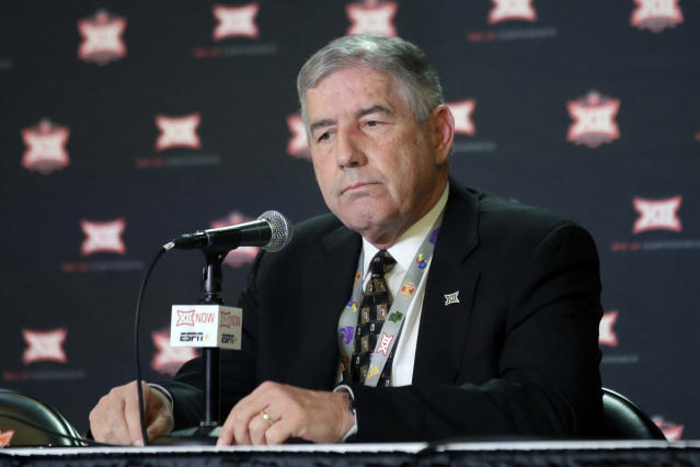 Big 12 Commissioner Bob Bowlsby announces no fans will be admitted to the rest of the Big 12 basketball tournament in Kansas City, Kan., Wednesday, March 11, 2020. The announcement came as fans gathered for the first round of the tournament. (AP Photo/Orlin Wagner)