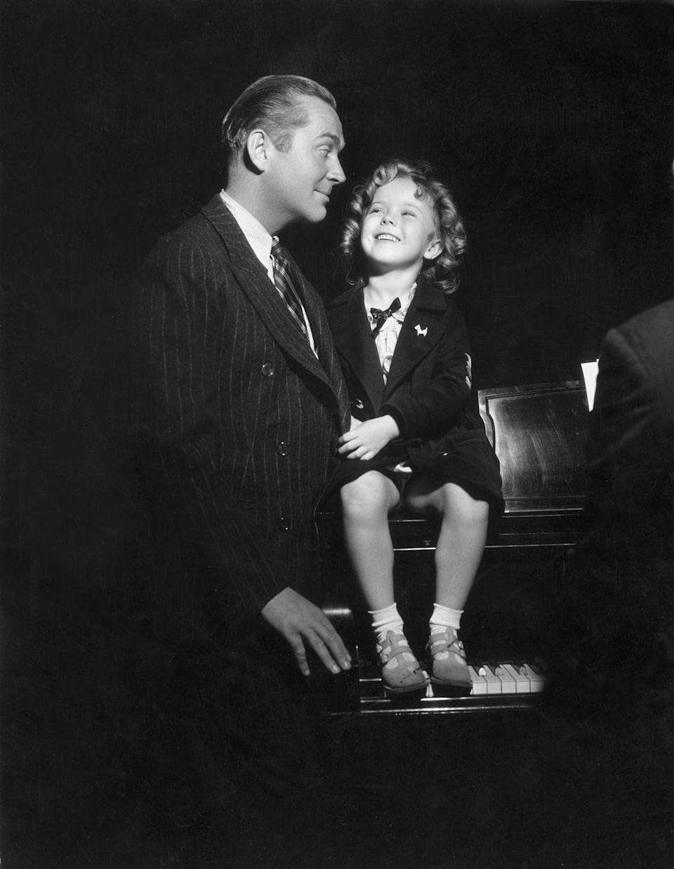 <p>James Dunn and Temple rehearse together for <em>Baby Take a Bow</em>, their fourth film together. </p>