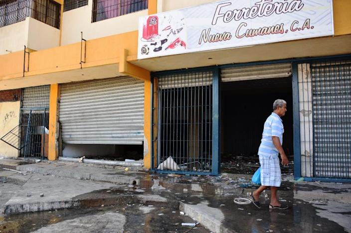 Residents barricaded their shops in Venezuela's Cumana after the country's food crisis erupted into deadly looting (AFP Photo/Manuel Trujillo)