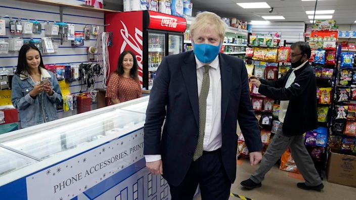 Boris Johnson wore a mask for the first time as he visited a shop in Uxbridge on Friday