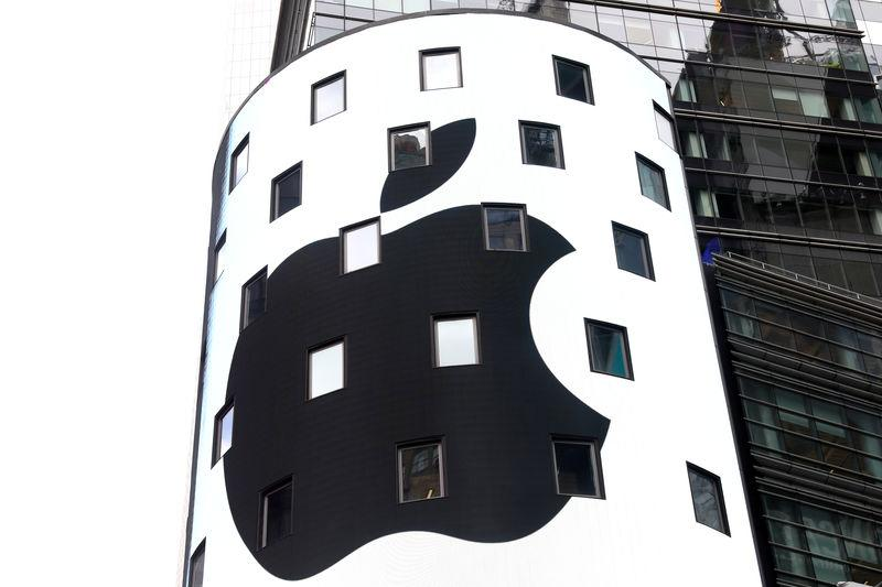 FILE PHOTO: An electronic screen displays the Apple Inc. logo on the exterior of the Nasdaq Market Site following the close of the day's trading session in New York City