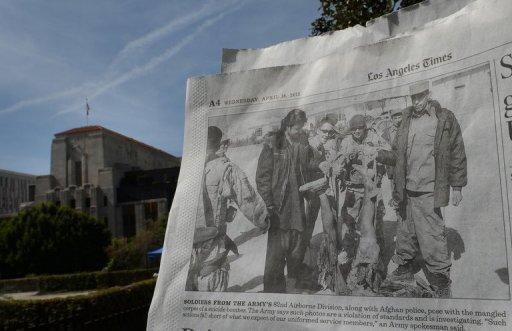 The Los Angeles Times (pictured) obtained an image of US soldiers posing with the remains of Taliban suicide bombers