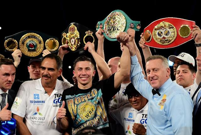 Gennady Golovkin poses with his belts after his second round TKO of Dominic Wade during their unified middleweight title fight in Inglewood, California (AFP Photo/Harry How)