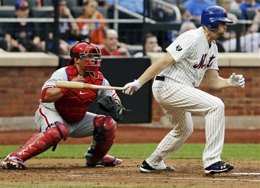 New York Mets' Jonathon Niese hits a two-run single during the second inning of a baseball game against the Philadelphia Phillies, Tuesday, July 3, 2012, in New York. (AP Photo/Frank Franklin II)