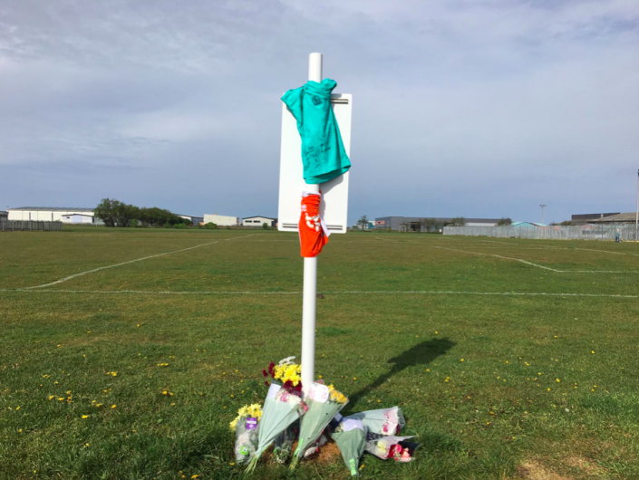 Tributes have been left for Jordan Banks at the playing field where he was apparently struck by lightning. (Reach)
