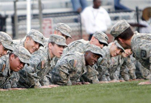 Members of UAB's Army ROTC do pushups after a touchdown in the first half of an NCAA college football game against Marshall at Legion Field in Birmingham, Ala., Saturday, Nov. 10, 2012. (AP Photo/Hal Yeager)