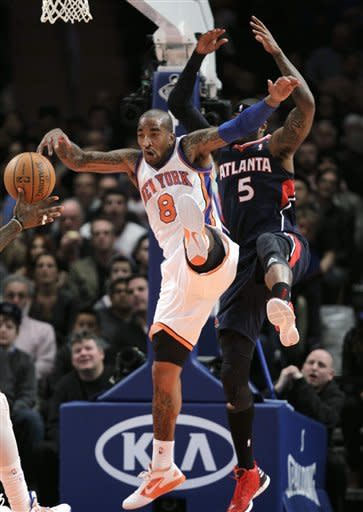 New York Knicks guard J.R. Smith (8) knocks down a rebound from Atlanta Hawks forward Josh Smith (5) in the second quarter of an NBA basketball game at Madison Square Garden in New York, Wednesday, Feb. 22, 2012. (AP Photo/Kathy Willens)