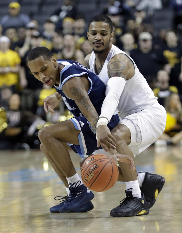 VCU's Marcus Evans, right, defends Rhode Island's Fatts Russell during the first half of an NCAA college basketball game in the Atlantic 10 men's tournament Friday, March 15, 2019, in New York. (AP Photo/Frank Franklin II)