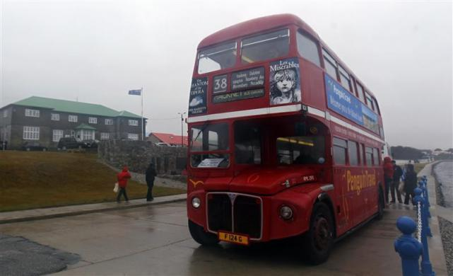 Tourists get into a double decker bus in Port Stanley March 15, 2012.