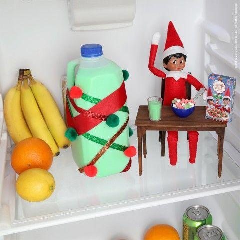 """<p>It's the most important meal of the day! So why not stash the Elf in your fridge when your kids go looking for their cereal milk—only to find it's now green Elf milk?</p><p><strong>Get the tutorial at <a href=""""https://www.elfontheshelf.com/elf-ideas/breakfast-of-scout-elf-champions"""" rel=""""nofollow noopener"""" target=""""_blank"""" data-ylk=""""slk:The Elf on the Shelf"""" class=""""link rapid-noclick-resp"""">The Elf on the Shelf</a>.</strong></p><p><a class=""""link rapid-noclick-resp"""" href=""""https://www.amazon.com/SXFSE-Dollhouse-Decoration-Accessories-Furniture/dp/B07V8JLCMX/ref=sr_1_3?tag=syn-yahoo-20&ascsubtag=%5Bartid%7C10050.g.22690552%5Bsrc%7Cyahoo-us"""" rel=""""nofollow noopener"""" target=""""_blank"""" data-ylk=""""slk:SHOP ELF TABLE"""">SHOP ELF TABLE </a></p>"""