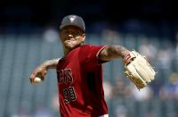 Arizona Diamondbacks pitcher Taijuan Walker throws a pitch against the Cleveland Indians during the second inning of a spring training baseball game Tuesday, March 27, 2018, in Phoenix. (AP Photo/Ross D. Franklin)
