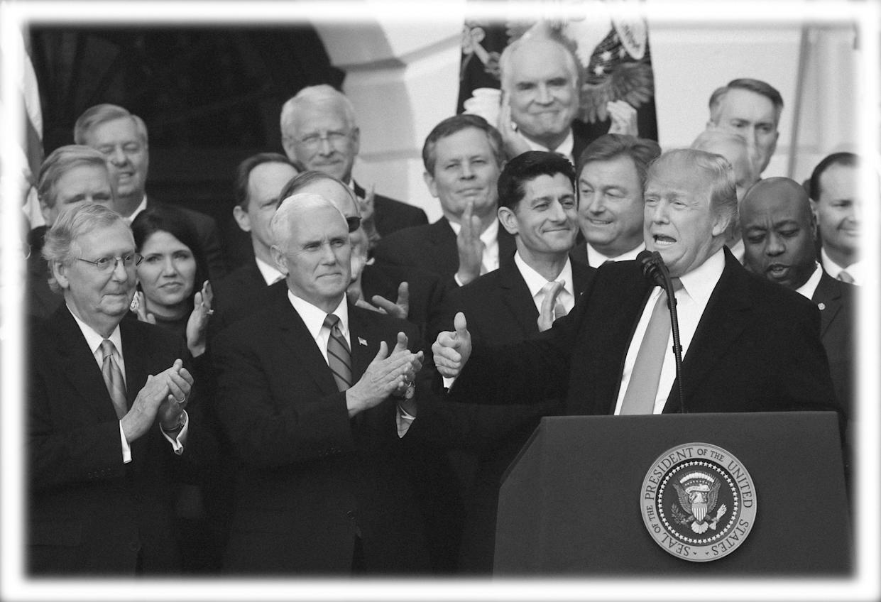 President Trump, with Vice President Mike Pence and members of Congress, speaks about the passage of the tax overhaul bill in December 2017. (Photo: Manuel Balce Ceneta/AP)