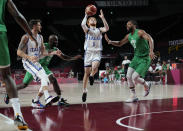 Italy's Niccolo Mannion (1), second right, drives to the basket during men's basketball preliminary round game against Nigeria at the 2020 Summer Olympics, Saturday, July 31, 2021, in Saitama, Japan. (AP Photo/Eric Gay)