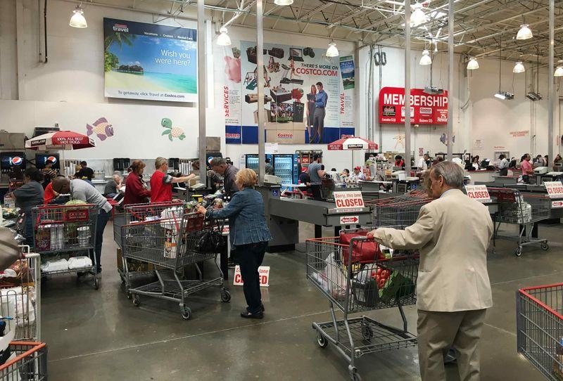 People are seen inside shopping at a Costco Wholesale warehouse club in Westbury, New York