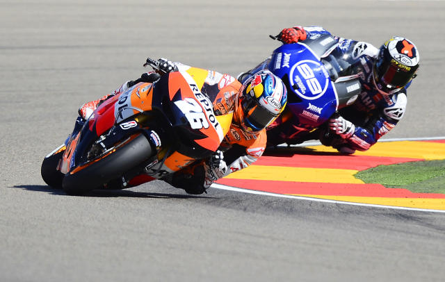 Repsol Honda Team Spanish rider Dani Pedrosa (L) leads on Yamaha Factory Racing Spanish rider Jorge Lorenzo during the Moto GP race of the Aragon Grand Prix at Motorland's race track in Alcaniz on September 30, 2012. Repsol Honda Team Spanish rider Dani Pedrosa won the race ahead of Yamaha Factory Racing Spanish rider Jorge Lorenzo and Monster Yamaha Tech 3 Italian rider Andrea Dovizioso. AFP PHOTO/ PIERRE-PHILIPPE MARCOUPIERRE-PHILIPPE MARCOU/AFP/GettyImages