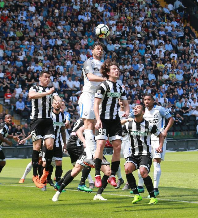 Inter's Andrea Ranocchia scores his side's first goal during the Italian Serie A soccer match between Udinese and Inter Milan at the Friuli stadium in Udine, Italy, Sunday May 6, 2018. (Alberto Lancia/ANSA via AP)