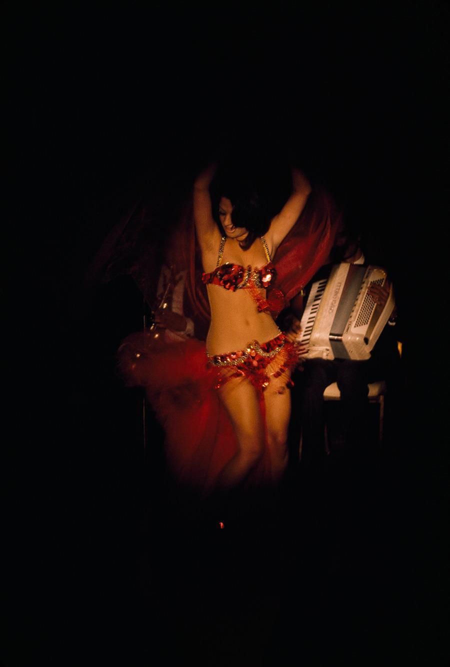 An Egyptian belly dancer performs for tourists in a nightclub in Cairo, 1972.