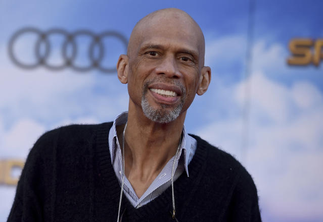 "FILE - In this June 28, 2017 file photo, former NBA star Kareem Abdul-Jabbar arrives at the Los Angeles premiere of ""Spider-Man: Homecoming"" at the TCL Chinese Theatre in Los Angeles. Abdul-Jabbar and tennis great Billie Jean King are lending their names to Athlete Ally, a nonprofit targeting homophobia in sports. (Photo by Jordan Strauss/Invision/AP, File)"