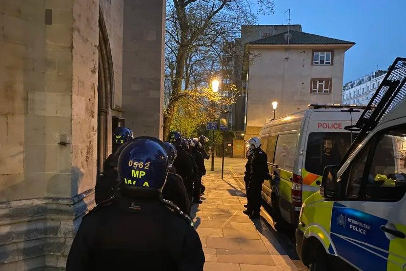 <p>Officers carrying out the raid</p> (Met Police)