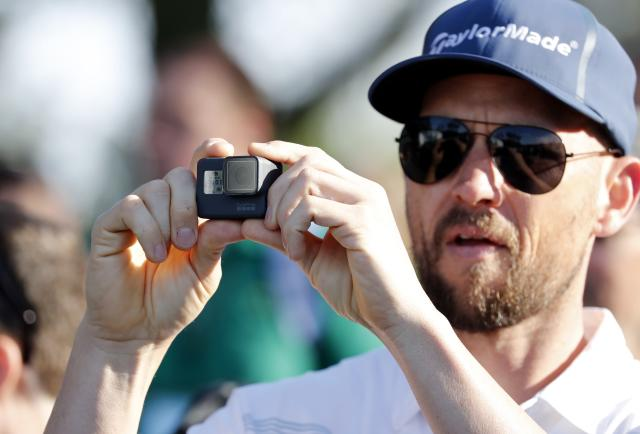 With the use of cell phones prohibited on the grounds at Augusta National patrons use cameras to take pictures during practice for the 2018 Masters golf tournament at Augusta National Golf Club in Augusta, Georgia, U.S. April 2, 2018. REUTERS/Jonathan Ernst