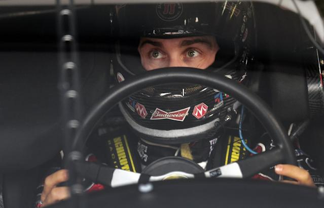Driver Kevin Harvick prepares to practice for Sunday's running of the NASCAR Sprint Cup Series auto race at Talladega Superspeedway in Talladega, Ala., Friday, Oct. 18, 2013