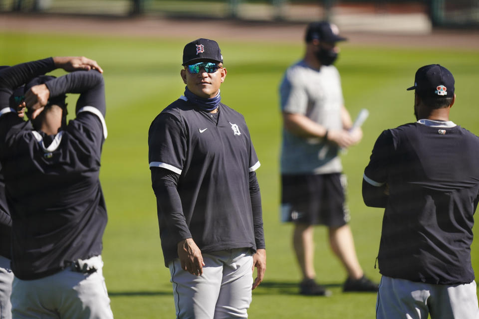 Detroit Tigers' Miguel Cabrera stands on the field with teammates during a spring training baseball workout Friday, Feb. 26, 2021, in Lakeland, Fla. (AP Photo/Frank Franklin II)