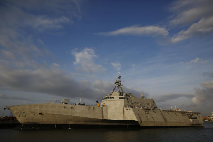 """FILE - This Nov. 30, 2016, file photo shows the USS Gabrielle Giffords, a Naval littoral combat ship built at the Austal USA shipyards, docked on the Mobile River in Mobile, Ala. China's spokesman Geng Shuang said Friday, Nov. 22, 2019, that the littoral combat ship USS Gabrielle Giffords """"illegally entered"""" waters surrounding the Spratly Islands on Nov. 20. (AP Photo/Brynn Anderson, File)"""
