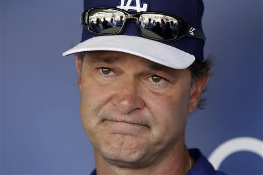 Los Angeles Dodgers manager Don Mattingly talks with reporters before a baseball game against the Miami Marlins in Los Angeles, Friday, May 10, 2013. (AP Photo/Reed Saxon)