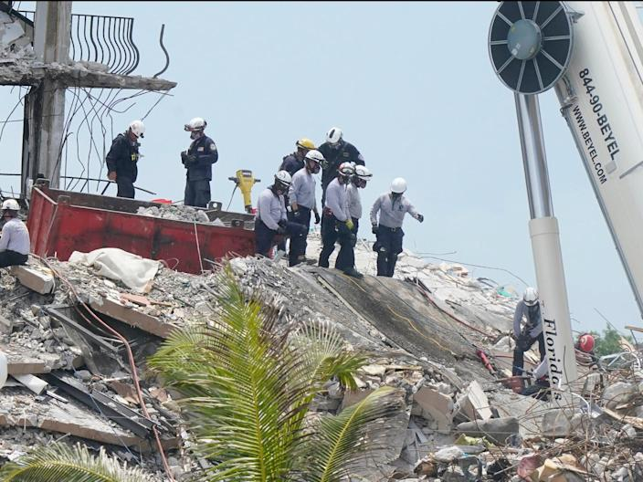 Rescue workers continue to search the rubble of Champlain Towers South (AP)