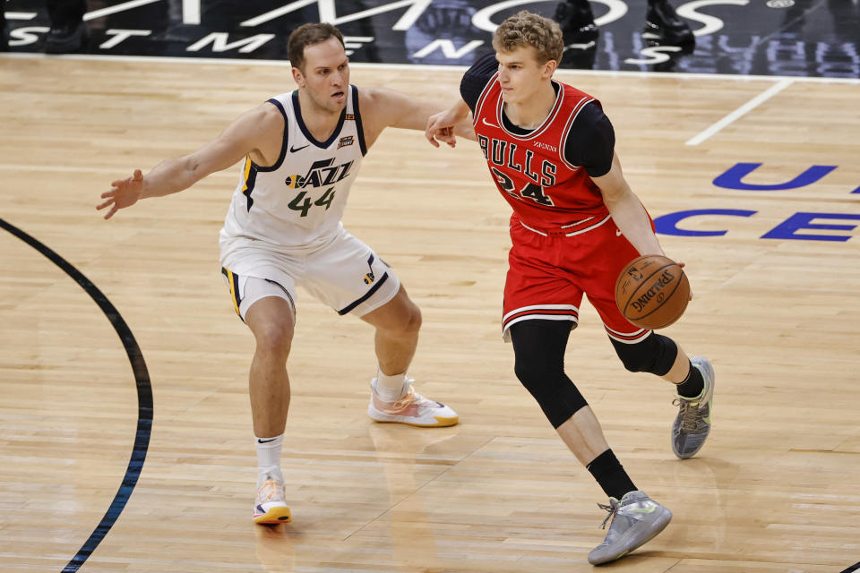 Mar 22, 2021; Chicago, Illinois, USA; Chicago Bulls forward Lauri Markkanen (24) is defended by Utah Jazz forward Bojan Bogdanovic (44) during the first half of an NBA game at United Center.