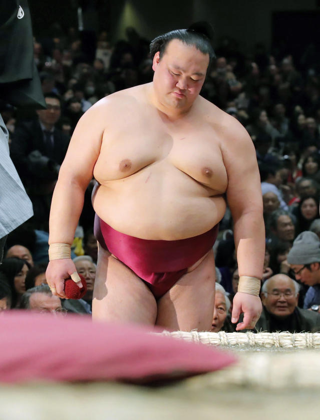 In this Tuesday, Jan. 15, 2019, photo, grand champion Kisenosato reacts after losing to Tochiozan at the New Year Grand Sumo Tournament in Tokyo. Kisenosato, the only Japanese wrestler at sumo's highest rank, has decided to retire after three straight losses at the tournament. (Kyodo News via AP)