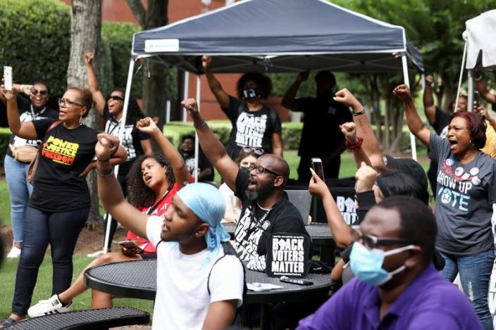 People gather at Ebenezer Baptist Church during a stop on the Freedom Ride For Voting Rights in Atlanta