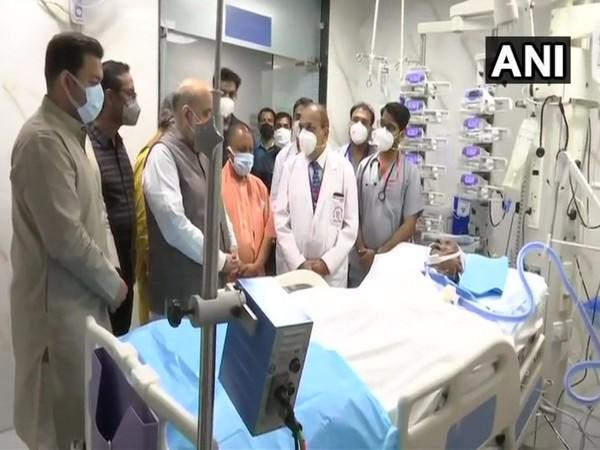 Union Home Minister Amit Shah and Chief Minister Yogi Adityanath at SGPGI hospital in Lucknow. (Photo/ANI)