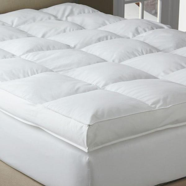 """<h3>The Company Store Legends Hotel PrimaLoft Down Alternative Topper</h3><br><strong>Best For: PrimaLoft Down-Alternative Sleep</strong><br>If you love the soft-feathered feel that a down topper provides but can't handle the allergens that come with it, this still-as-soft style is a perfect alternative. The TCS Down-free fill is stuffed inside 4-inch deep and 15-inch wide quilted squares that make for a fully lofted """"sink-right-in"""" sleep situation.<br><br><strong>The Hype: 4.2 out of 5 stars</strong><br><br><strong>Sleepers Say:</strong> """"I really like these feather-bed toppers. They are really comfortable. I like a firm bed, in the sense of providing support - no sagging. With these toppers on top of the mattress, it feels soft on my skin and bones but still provides the support of a firm mattress. I also like that I can take it off and air it out or reposition the filling - something you can't do with a pillow top that is part of the mattress."""" <em>– Crager, The Company Store Reviewer</em><br><br><em>Shop </em><strong><em><a href=""""https://www.thecompanystore.com/selections/baffled-square-down-free-softbed/FA20-F-WHITE.html"""" rel=""""nofollow noopener"""" target=""""_blank"""" data-ylk=""""slk:The Company Store"""" class=""""link rapid-noclick-resp"""">The Company Store</a></em></strong><br><br><strong>The Company Store</strong> Legends Hotel™ PrimaLoft® Down Alternative Topper, $, available at <a href=""""https://go.skimresources.com/?id=30283X879131&url=https%3A%2F%2Fwww.thecompanystore.com%2Fmattress-toppers%2Fprimaloft-black-label-fiberbed%2FFA26.html"""" rel=""""nofollow noopener"""" target=""""_blank"""" data-ylk=""""slk:The Company Store"""" class=""""link rapid-noclick-resp"""">The Company Store</a>"""