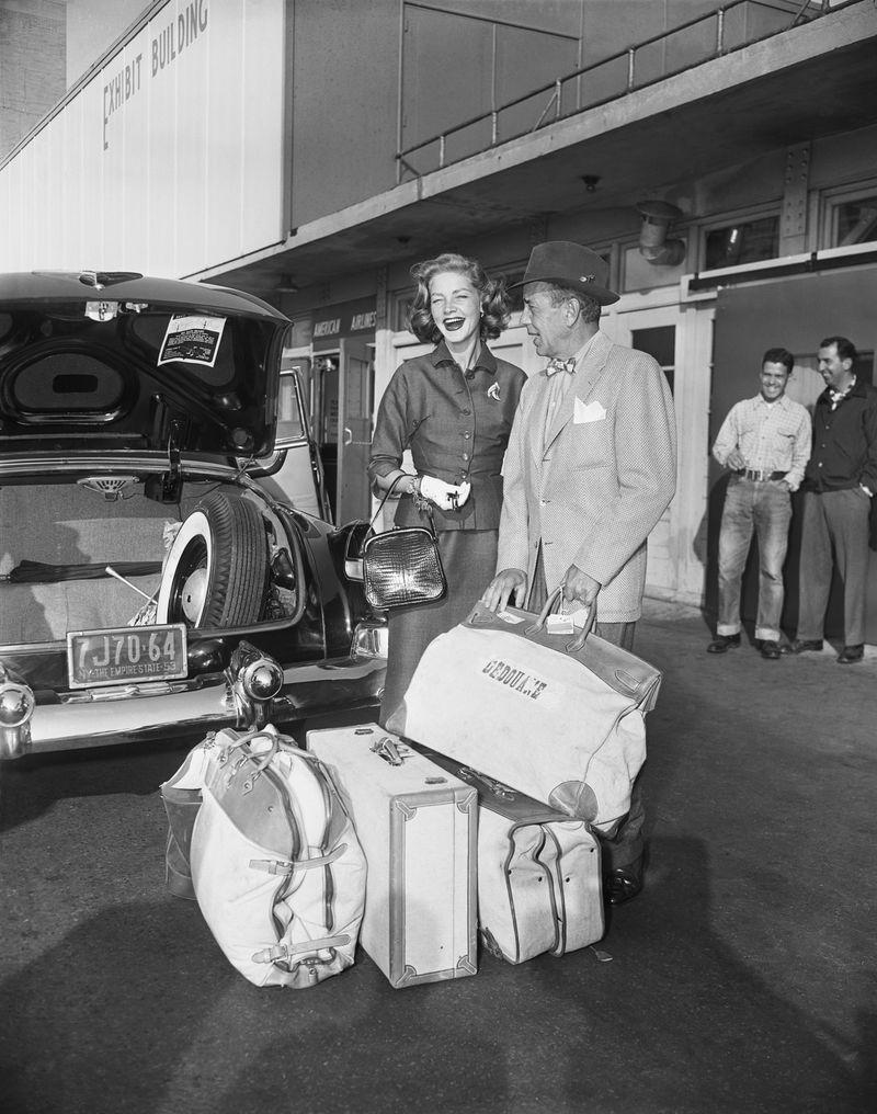 <p>The Hollywood golden couple is all smiles, despite a heap of luggage, as they journey from Los Angeles to New York City for vacation in 1953. </p>