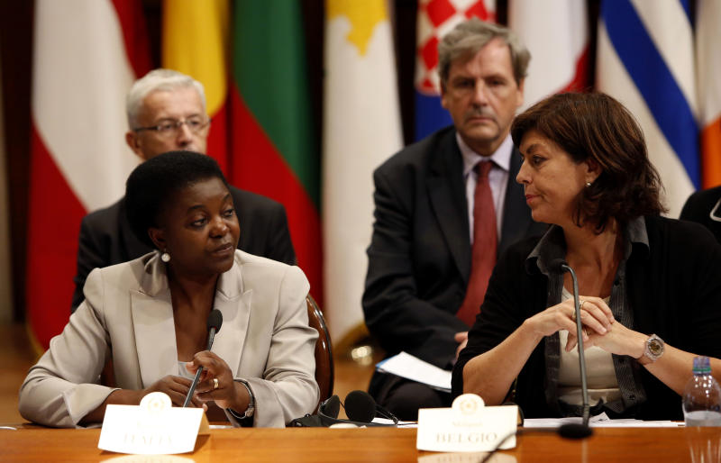 """Belgian Deputy Premier Joelle Milquet, right, looks at Italian Integration Minister Cecile Kyenge, during a press conference at the end of the European Integration Ministers Meeting at Chigi Palace government office in Rome, Monday, Sept. 23, 2013. Cabinet ministers from more than a dozen European nations have come to Rome in a show of support for Italy's first black cabinet minister who has been attacked with racist taunts ever since she was appointed in April. The ministers signed a declaration Monday condemning racism as anathema to Europe's democratic principles. They said the attacks that Cecile Kyenge has been subjected to were unacceptable and must stop, particularly since they have come from politicians. Members of Italy's xenophobic Northern League party have called the Congolese-born Kyenge """"Congolese monkey"""" and other epithets. Belgium's deputy prime minister Joelle Milquet sponsored the initiative. (AP Photo/Riccardo De Luca)"""