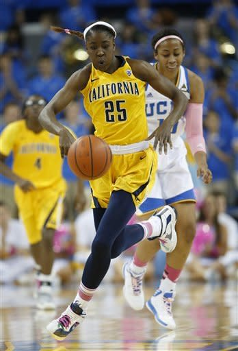 California forward Gennifer Brandon (25) makes her way downcourt past UCLA forward Kacy Swain during the first half of an NCAA college basketball game in Los Angeles, Friday, Feb. 15, 2013. (AP Photo/Jae C. Hong)
