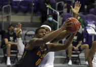 Baylor guard Mark Vital (11) tries to put up a shot past TCU forward Kevin Easley (34) in the second half of an NCAA college basketball game, Saturday, Jan. 9, 2021, in Fort Worth, Texas. (AP Photo/ Richard W. Rodriguez)