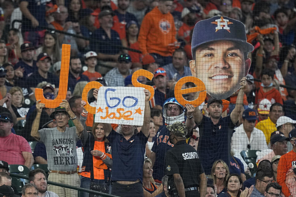 Spectators cheer for Houston Astros second baseman Jose Altuve during the first inning in Game 1 of a baseball American League Division Series between the Houston Astros and the Chicago White Sox Thursday, Oct. 7, 2021, in Houston. (AP Photo/David J. Phillip)