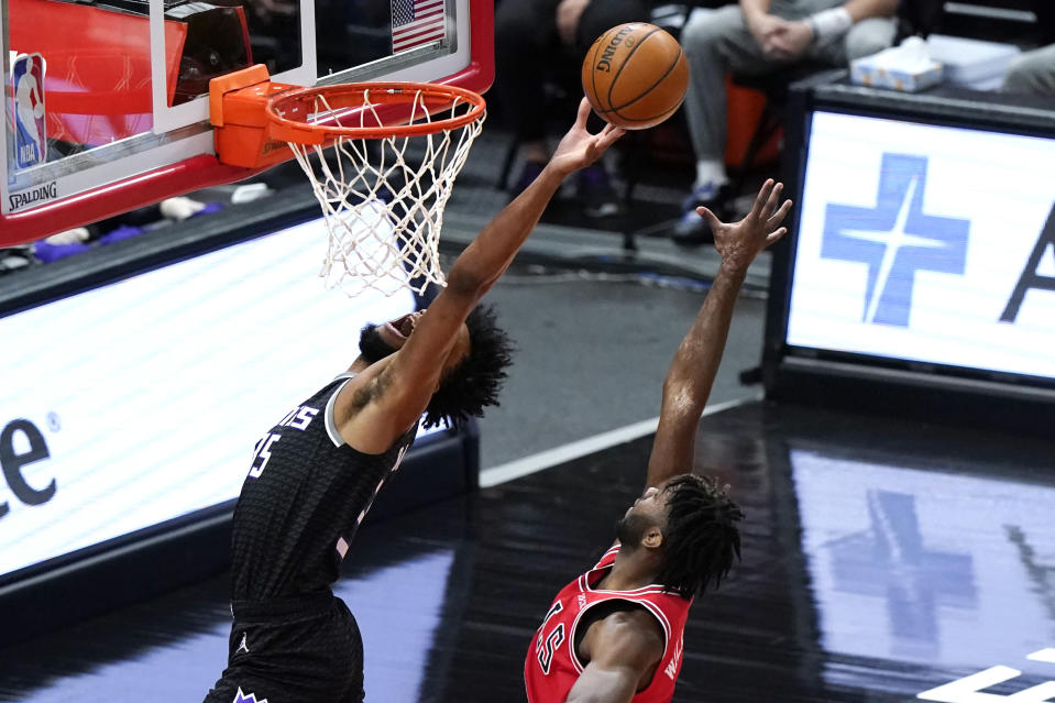 Sacramento Kings forward Marvin Bagley III, left, drives to the basket past Chicago Bulls forward Patrick Williams during the first half of an NBA basketball game in Chicago, Saturday, Feb. 20, 2021. (AP Photo/Nam Y. Huh)