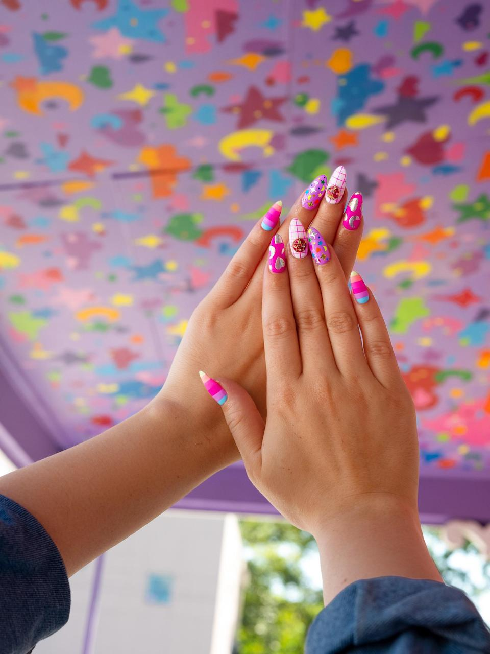 Eye-catching nail art is the main attraction.