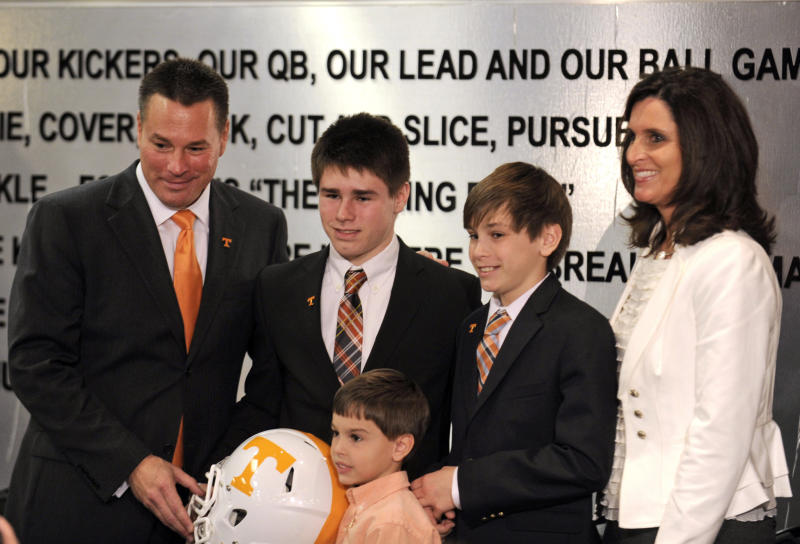 New University of Tennessee football coach Butch Jones, left, poses with his wife, Barb, and sons, Alex, 16, Adam, 12, and Andrew, 5, during an NCAA college football new conference on Friday, Dec. 7, 2012, in Knoxville, Tenn. The Vols' introduced Jones on Friday as its successor to Derek Dooley, who was fired Nov. 18 after going 15-21 in three seasons. (AP Photo/Knoxville News Sentinel, Amy Smotherman Burgess)