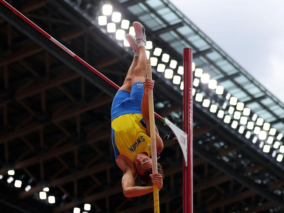 Armand Duplantis of Sweden pushes off the pole at the pole vault in the Tokyo Olympics.