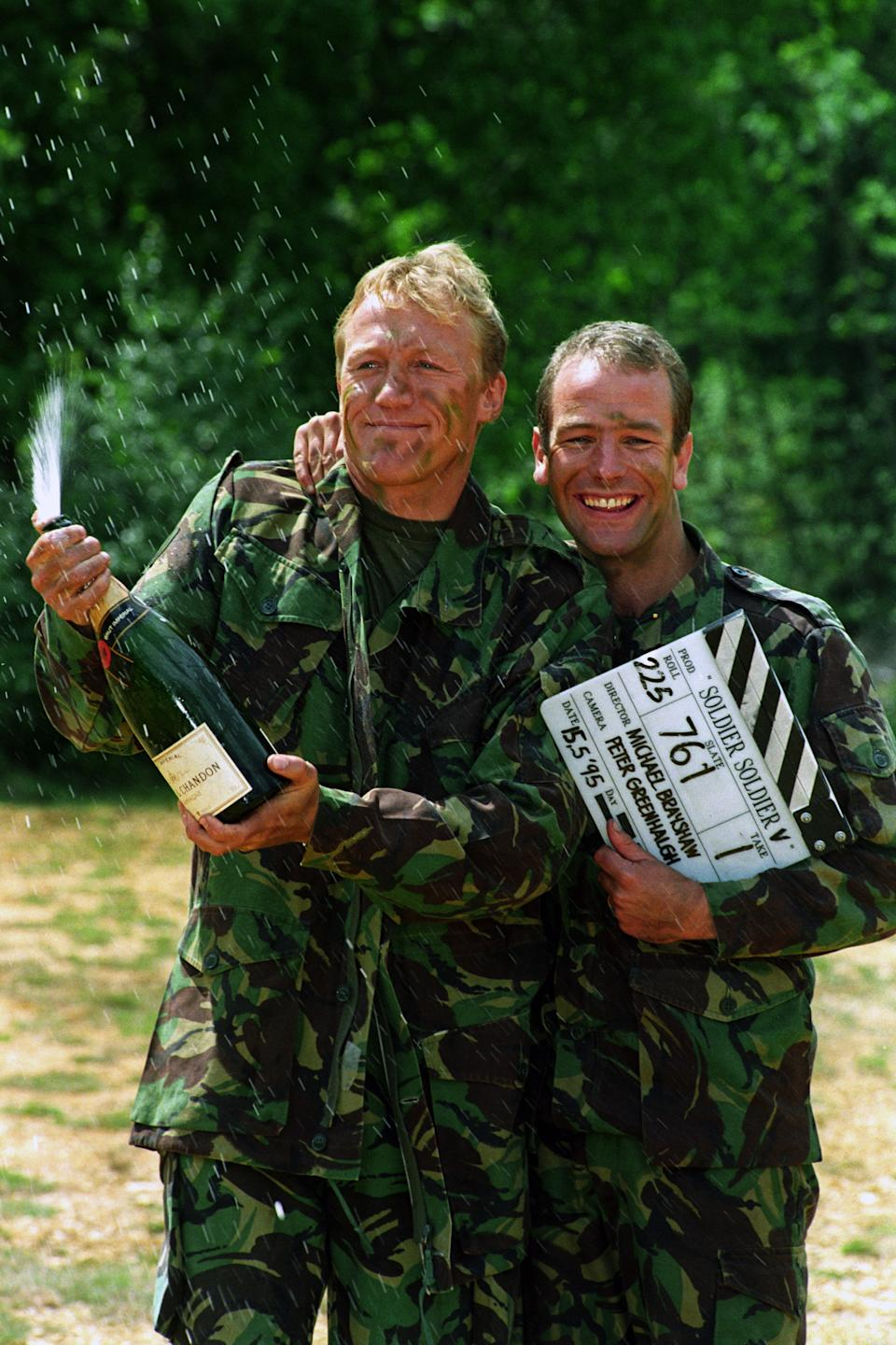 JEROME FLYNN AND ROBSON GREEN, ON RIGHT, CELEBRATING THEIR NO 1 HIT RECORD, UNCHAINED MELODY, TAKEN FROM THE ITV PROGRAMME SOLDIER SOLDIER.   (Photo by Tim Ockenden - PA Images/PA Images via Getty Images)