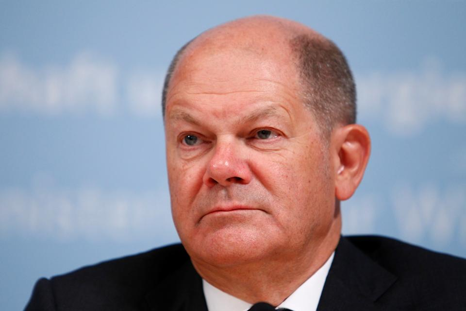 Germany's Finance Minister Olaf Scholz attends a news conference after Chancellor Angela Merkel and state premiers reached an agreement with the regions most affected by the planned brown coal exit, in Berlin, Germany, January 16, 2020. REUTERS/Michele Tantussi