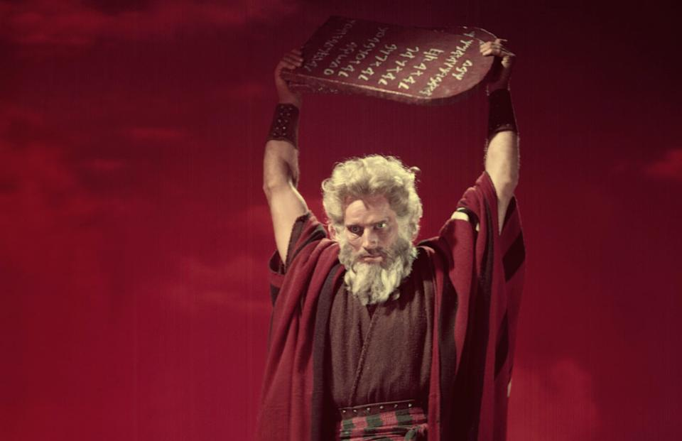 Charlton Heston hoists the Ten Commandments above his head in Cecil B. DeMille's 1956 epic 'The Ten Commandments' (Photo: Courtesy Everett Collection)